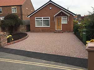 Red driveway in Hedon resin bound stone