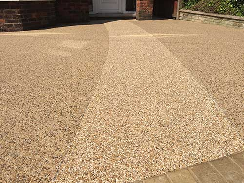 Curved pathway set into resin driveway