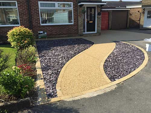 curved path set into resin driveway