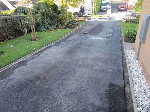 tarmac drive. Damaged but prepped for new surfacing