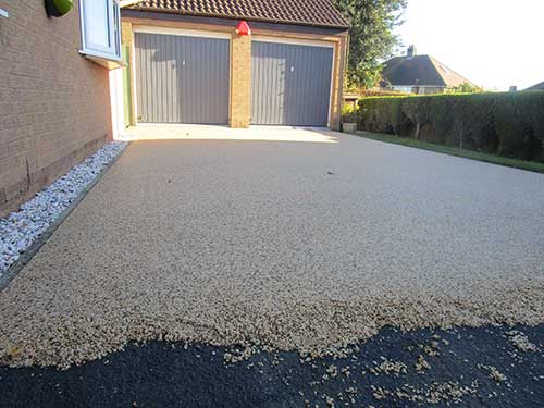 Ground shot of resin bound surfacing on tarmac
