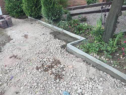 Pin kerbs at edge of new resin driveway