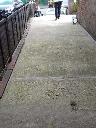 Block paved edges to raise level of old drive