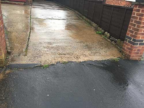 Edge of old concrete driveway