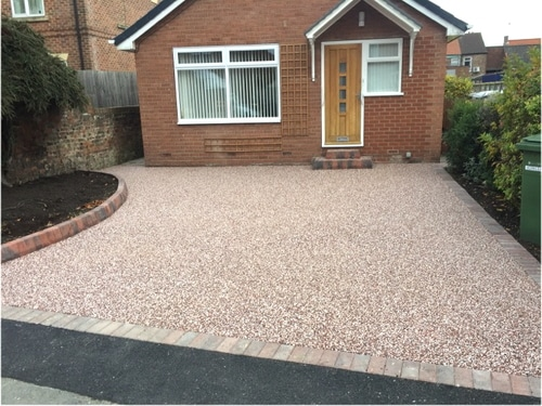 Completed red resin bound driveway in Hedon near Hull.