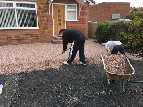Laying main section of red resin driveway in Hedon near Hull