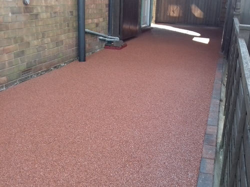 Completed red resin bound driveway in Scunthorpe. Covered over origional concrete