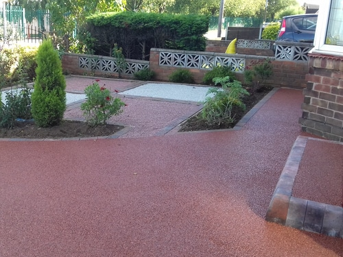 Completed red resin drive in Scunthorpe. Steps and garden area