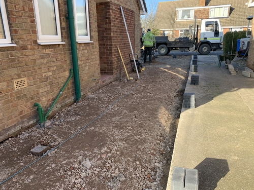 Breaking out badly installed resin driveway in Hull