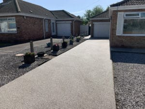 Garden view of grey resin drive in Willerby