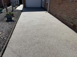 middle section of grey resin driveway